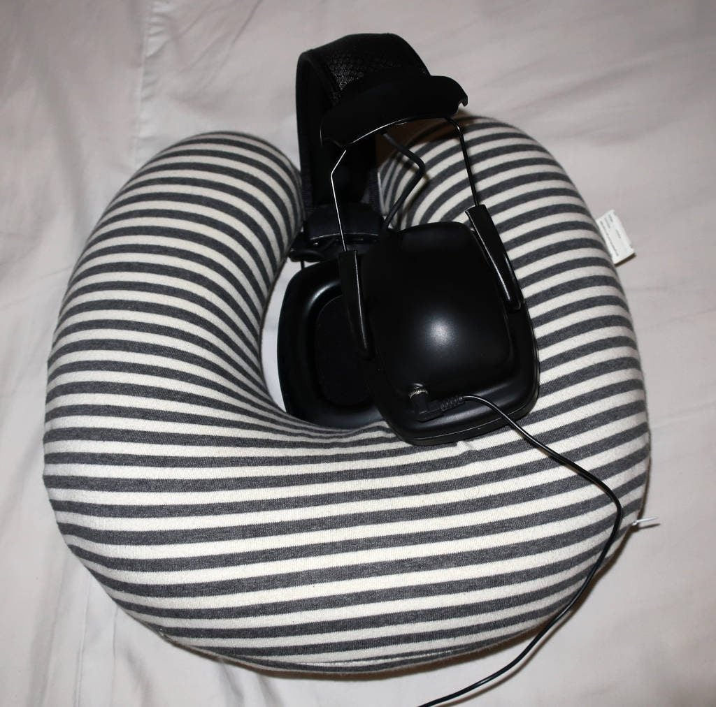 Sleeping with full-size headphones and earmuffs
